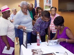 Cheryl Wills signs copies of her book